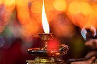 Diwali candle diya or butter lamps with bokeh.