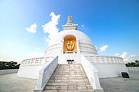 World Peace Stupa in Lumbini, Nepal. World Peace. The non-english text translates to nanmyouhourrnn, a Buddhist Script roughly translating to May Peac...