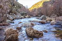 River Estena flowing in winter. Boqueron de Estena hiking Route at National Park of Cabaneros, Spain.