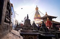 Kathmandu, Nepal - November 17 2019 - Sunrise morning view of Swayambhunath Stupa or Monkey Temple Buddhist Monastery in Kathmandu, Nepal. A UNESCO Wo...