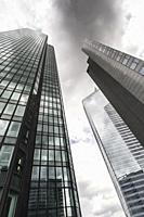 dark clouds over high-rise office buildings, la defense, paris, ile de france, france.