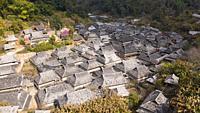 Aerial view of the remote Nuogang Dai village in Lancang, Yunnan - China.