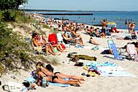 Many sunbathing people at the beach in Ystad, Scania, Sweden.