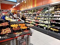 Shopper in Market, Ottestad, Norway.