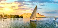 Sailboat on river Nile at sunset in Aswan, Egypt.