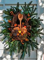 Christmas decoration on the bakery in Colonial Williamsburg Virginia, wreath includes bakers wares and tools.