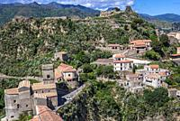 Savoca village on Sicily Island in Italy - view with ruins of Pentefur castle on a hill and Chiesa Madre di Savoca church on foreground.