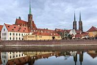 Collegiate Church of the Holy Cross and St Bartholomew and Cathedral of Saint John the Baptist in Ostrow Tumski, oldest part of Wroclaw city, Poland.
