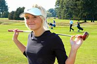 Blond girl, smiling and look at camera, on a golf course in Ystad, Scania, Sweden.