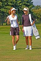 Two girls, golfer, walking on a golf course in Ystad, Scania, Sweden.