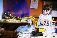 Child builds bulldozer lego.