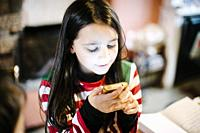Little girl with smartphone.
