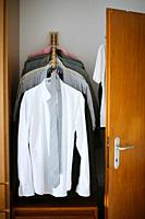 Closet with men´s clothing.