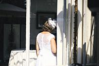 Bride behind glass window an old villa, Lombardy, Italy.