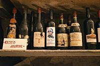 Antique bottles of Italian wine, It appears on the label of a bust of Mussolini.