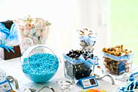 Table with glass jars filled with candy.