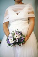 Bride with bouquet in hands.