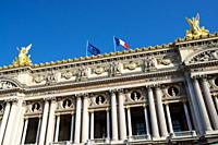 Opera building with French and European flags waving, Paris in France.
