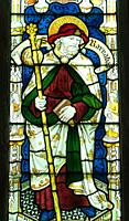 Stained glass depicting St Barnabas, St Mary's Priory Church, Abergavenny Wales UK. May 2019.
