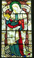 Stained glass depicting St Lydia, St Mary's Priory Church, Abergavenny Wales UK. May 2019.