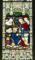 Stained glass depicting St Paul healing the sick, St Mary's Priory Church, Abergavenny Wales UK. May 2019.
