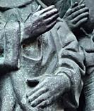 Three hands on bronze sculpture