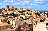 View of the town and its church of Asuncion, Calaceite, Matarraña region, Teruel, Aragon, Spain.