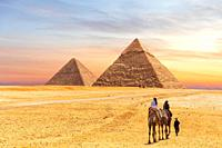 Egyptian Pyramids of Giza and the tourists on a camel.