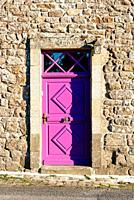 Old Purple closed door in stone wall. Retro style.