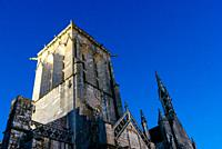 Close up detail of the facade of the churh of Saint Ronan in Locronan against blue sky.