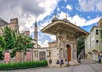 """Istambul, Turkey â. """" 07. 12. 2019. Carpet Museum near the Entrance gate to the Topkapi Palace in Istanbul, Turkey, on a cloudy summer day."""