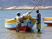 Fishermen getting ready to go fishing with traditional fishing boats near Baia das Gatas. Island Sao Vicente, Cape Verde an archipelago in the equator...
