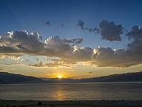 Landscape at Toktogul Reservoir and river Naryn in the Tien Shan or heavenly mountains. Energy is one of the most important export commodities. Asia, ...
