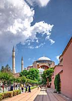 "Istambul, Turkey â. "" 07. 12. 2019. Hagia Sophia museum in Sultan Ahmed Park, Istanbul, Turkey, on a cloudy summer day."
