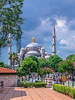 """Istambul, Turkey â. """" 07. 12. 2019. Many tourists walk around Sultan Ahmet Park on the site of a former Hippodrome in Istanbul, Turkey, on a cloudy su..."""
