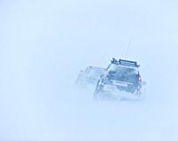 Jeeps traveling in a blizzard, Iceland.