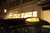 Taxi in London in the night. Close up taxi light.