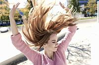 Portrait of young woman with flying hair. Munich, Germany.
