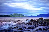Waves breaking on the rocky shore along Sitka Sound near Sitka, Alaska, USA.
