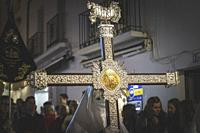 Cross guide in a procession at the holy week in Marbella with nazarene.