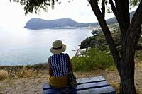 Woman looks at Canneto, Island of Lipari, Aeolian Islands, Italy.
