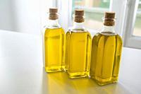 Three oil bottles.