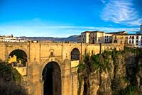 view at the famous el Tajo Gorge with the old bow bridge at village Ronda in Andalucia, Spain
