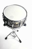 A snare drum or side drum is a percussion instrument that produces a sharp staccato sound when the head is struck with a drum stick, due to the use of...