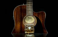 Music concept image, classic guitar with a Whiskey glas on a black background, Jazz, rock, blues music or life style concept.