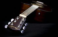 Music concept image, classic guitar on a black background, Jazz, rock, blues music or life style concept.