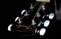 Close up image form a classic guitar on a black background painted with light.