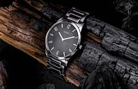 life style watch on grunge and burned wood log.