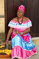 Cuban Woman with Cigar in Traditional Dress, Old Town, UNESCO World Heritage Site, Havana, Cuba