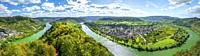 the bend of the Moselle river near Pünderich on the right, Germany, Marienburg Castle in the middle, panorama with steep vineyards and riverscape.